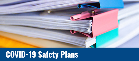 Photo of A stack of papers with COVID-19 Safety Plan text over it